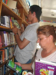 Adults using bookmobile